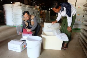 ASEAN-ERAT member reviews the status of ASEAN's relief items in Sittwe warehouse in Rakhine