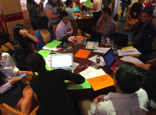 Journalists pitch and discuss stories at a Reporting ASEAN workshop.